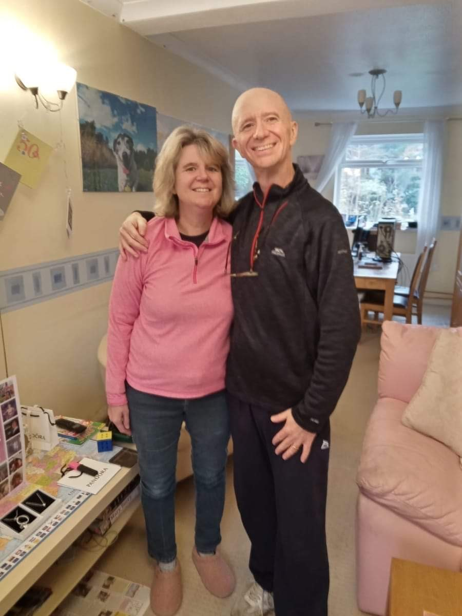 Andy Thomson with his wife in their living room