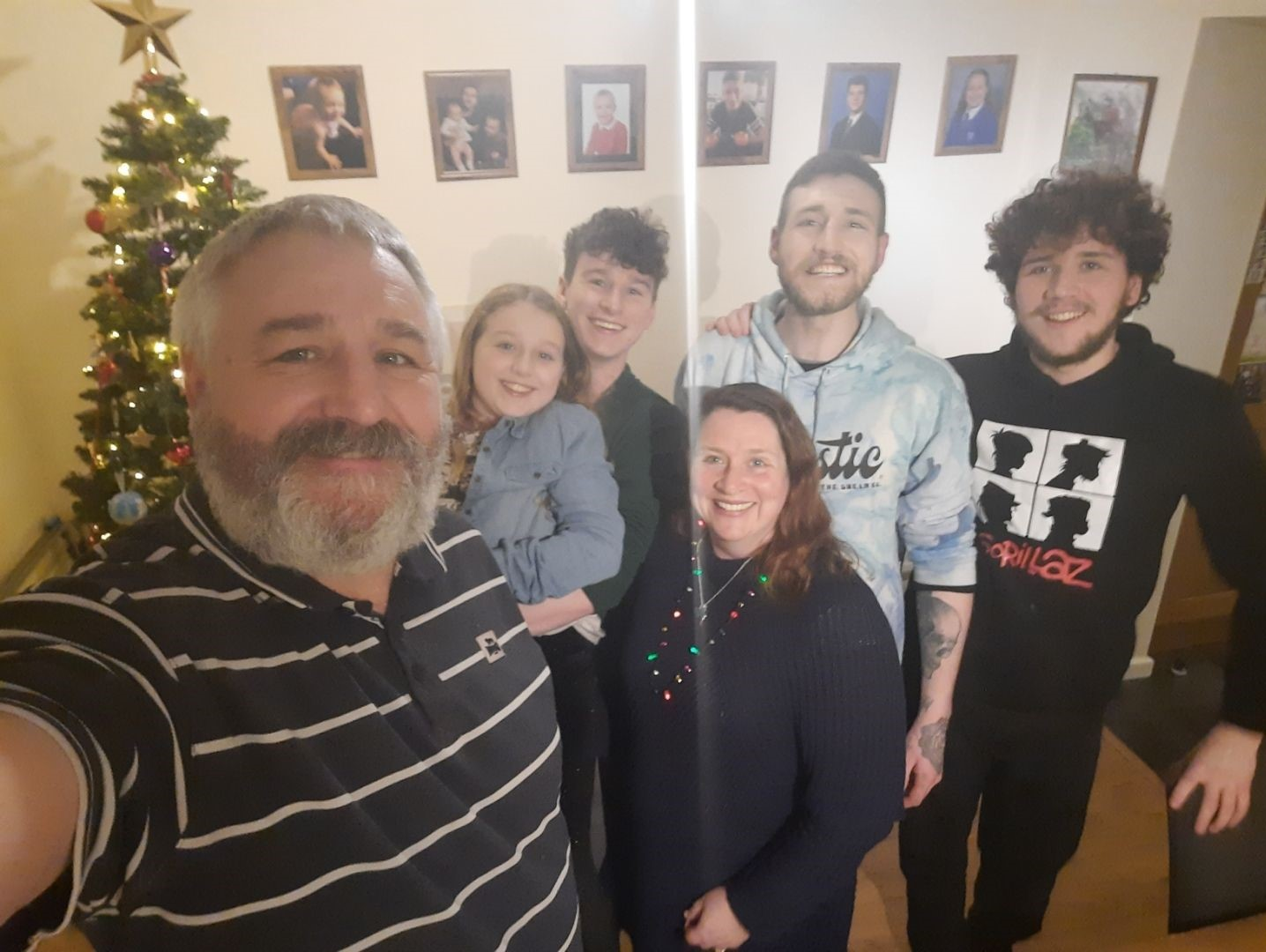 David Howard with his family around the Christmas tree