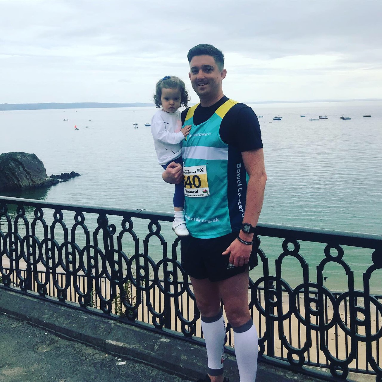 Wales fundraising manager Mike Locke pictured here in Bowel Cancer UK running vest with his daughter